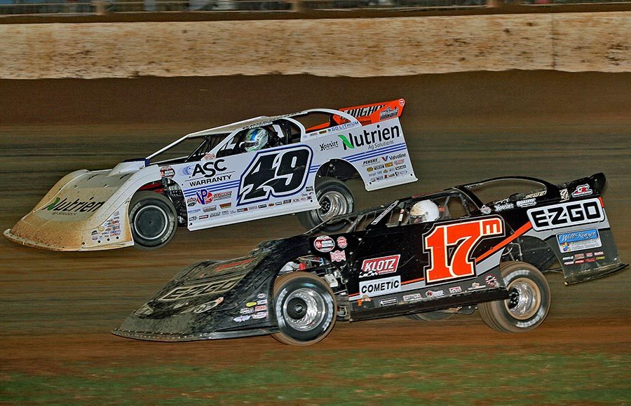 Dale McDowell (17m) races under Jonathan Davenport during Saturday's World of Outlaws Morton Buildings Late Model Series finale at The Dirt Track at Charlotte. (Jim Denhamer Photo)