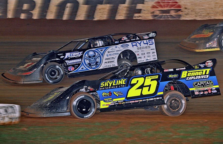 Shane Clanton (25) races under Scott Bloomquist during Saturday's World of Outlaws Morton Buildings Late Model Series finale at The Dirt Track at Charlotte. (Jim Denhamer Photo)