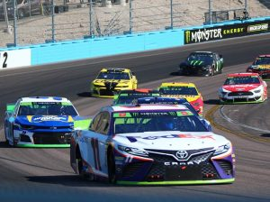 Denny Hamlin (11) leads a pack of cars Sunday at ISM Raceway. (Ivan Veldhuizen Photo)