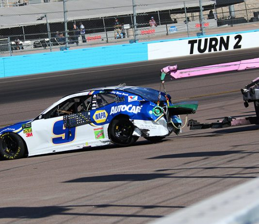 Chase Elliott's car is hauled away by a wrecker after a crash Sunday at ISM Raceway. (Ivan Veldhuizen Photo)