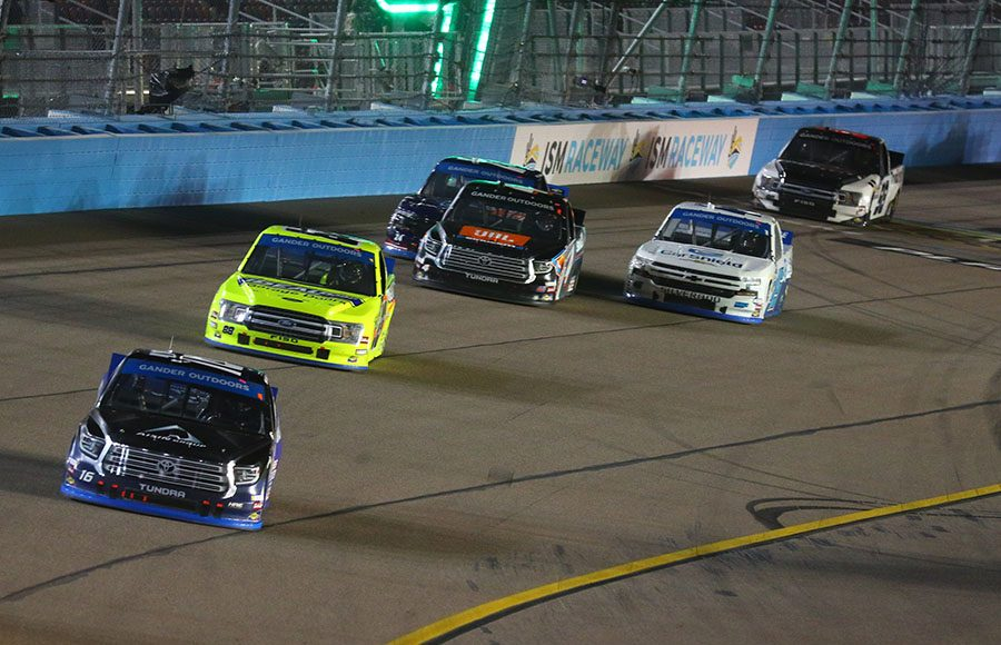 Austin Hill (16) leads a pack of cars during Friday's NASCAR Gander Outdoors Truck Series Lucas Oil 150 at ISM Raceway. (Ivan Veldhuizen Photo)