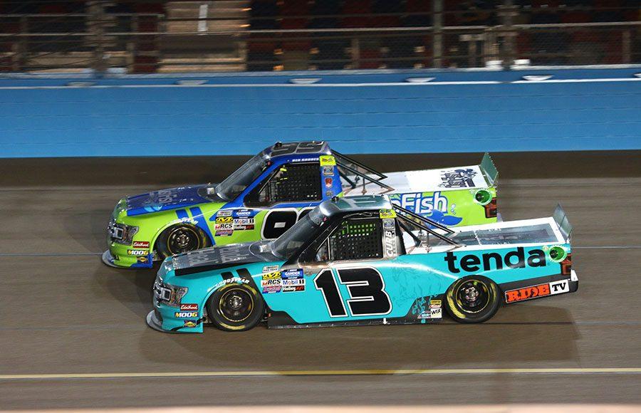 Johnny Sauter (13) battles Ben Rhodes during Friday's NASCAR Gander Outdoors Truck Series Lucas Oil 150 at ISM Raceway. (Ivan Veldhuizen Photo)