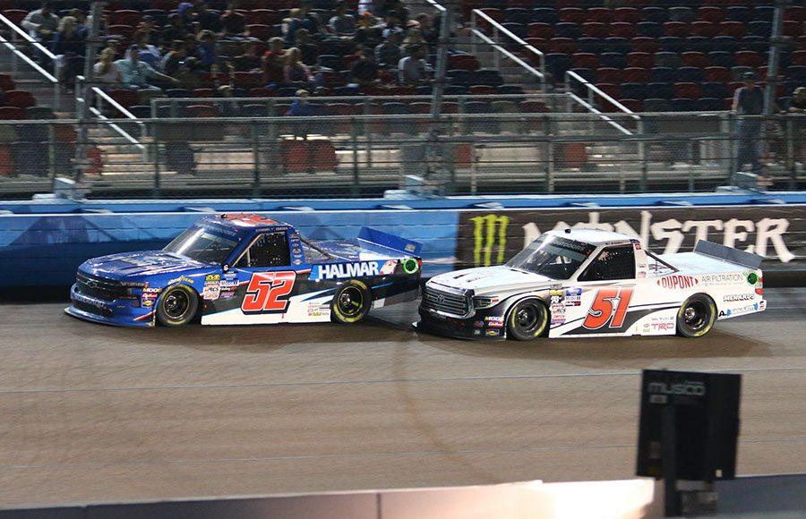 Stewart Friesen (52) fends off Brandon Jones in a battle for the race lead during Friday's NASCAR Gander Outdoors Truck Series Lucas Oil 150 at ISM Raceway. (Ivan Veldhuizen Photo)