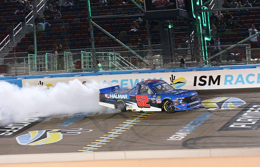 Stewart Friesen celebrates with a burnout after winning Friday's NASCAR Gander Outdoors Truck Series race at ISM Raceway. (Ivan Veldhuizen Photo)