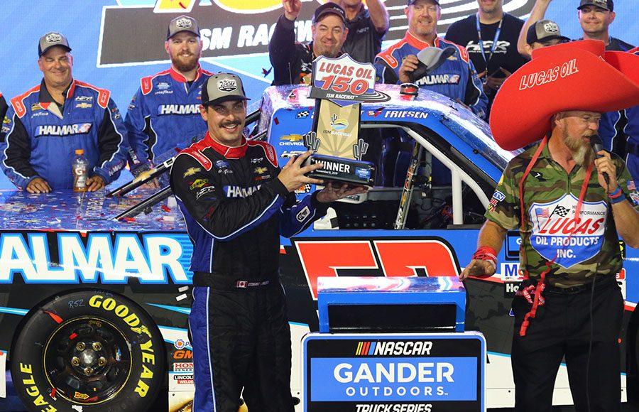 Stewart Friesen poses in victory lane after winning Friday's NASCAR Gander Outdoors Truck Series Lucas Oil 150 at ISM Raceway. (Ivan Veldhuizen Photo)