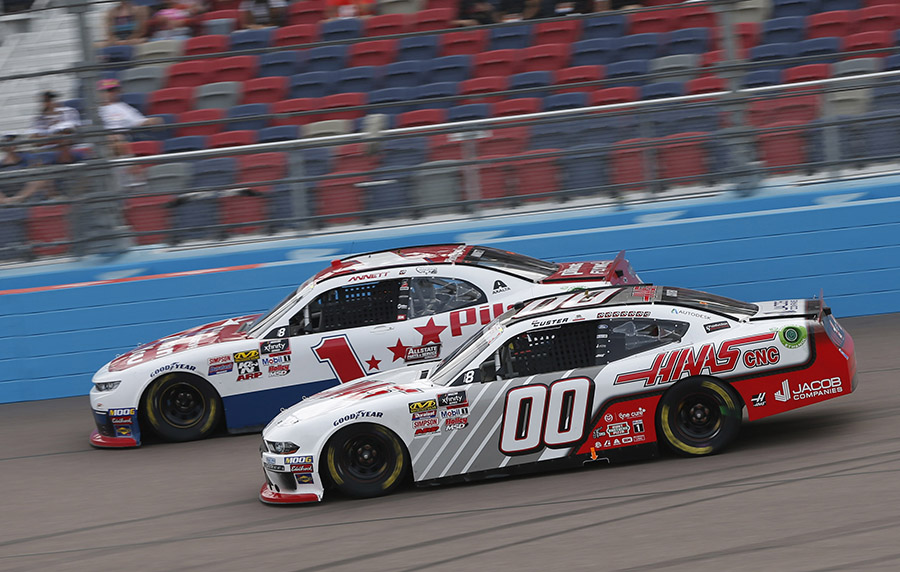 Cole Custer (00) races under Michael Annett during Saturday's NASCAR Xfinity Series race at ISM Raceway. (HHP/Ashley Dickerson Photo)