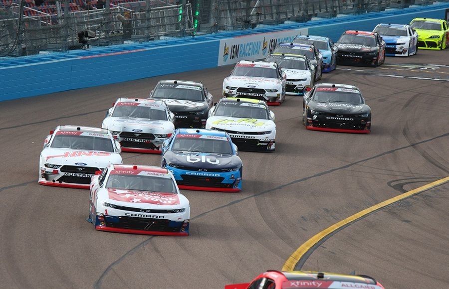 Michael Annett (1) leads a pack of cars during Saturday's NASCAR Xfinity Series race at ISM Raceway. (Ivan Veldhuizen Photo)
