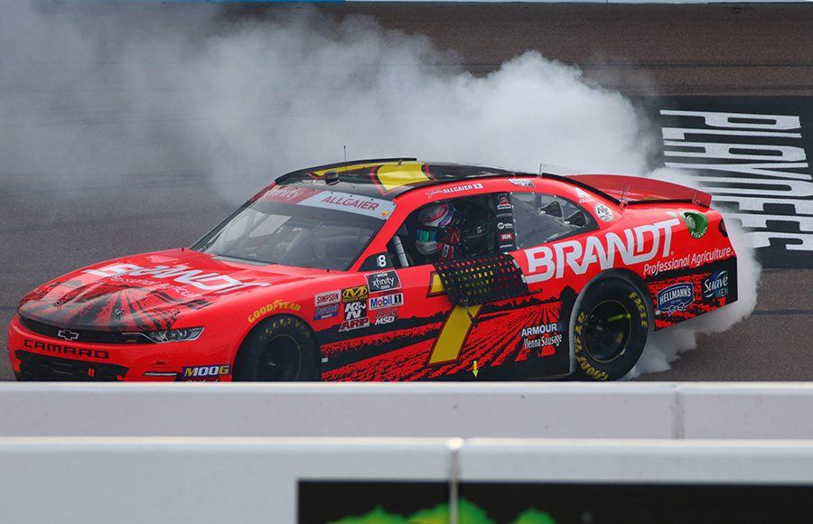Justin Allgaier celebrates with a burnout after winning Saturday's NASCAR Xfinity Series race at ISM Raceway. (Ivan Veldhuizen Photo)