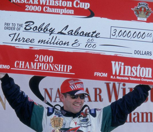 12 Nov 2000: Driver Bobby Labonte #18 poses with his winning check after winning the Pennzoil 400, part of the NASCAR Winston Cup Series at the Homestead Miami Speedway in Homestead, Florida.Mandatory Credit: Jon Ferrey /Allsport