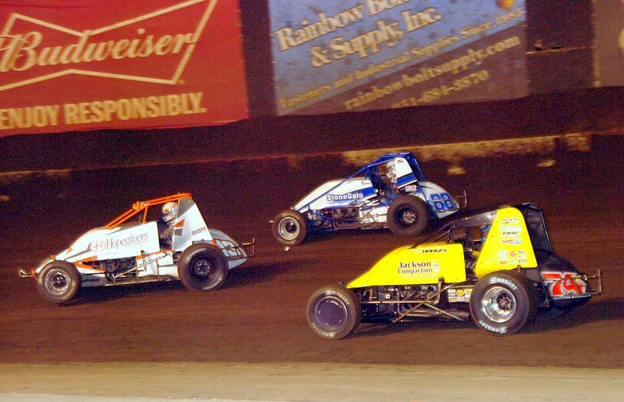 Josh Hodges (74x), Thomas Meseraull (13M), and Jace Vander Weerd battle for position during Saturday's Oval Nationals finale at Perris Auto Speedway. (Hein Brothers Photo)