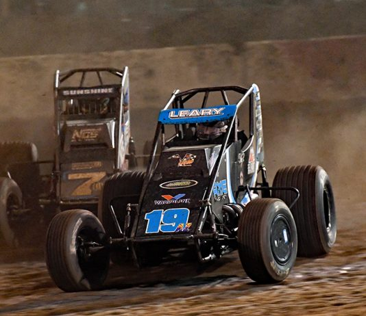 C.J. Leary (19) races ahead of Tyler Courtney during Saturday's Oval Nationals finale at Perris Auto Speedway. (Steve Himelstein Photo)
