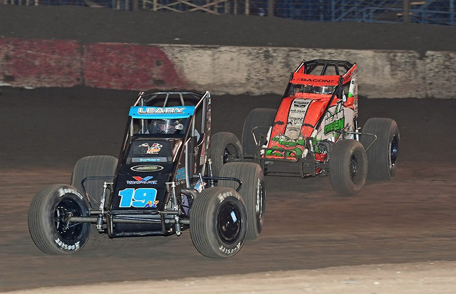 C.J. Leary (19) leads Brady Bacon during Saturday's Oval Nationals finale at Perris Auto Speedway. (Steve Himelstein Photo)