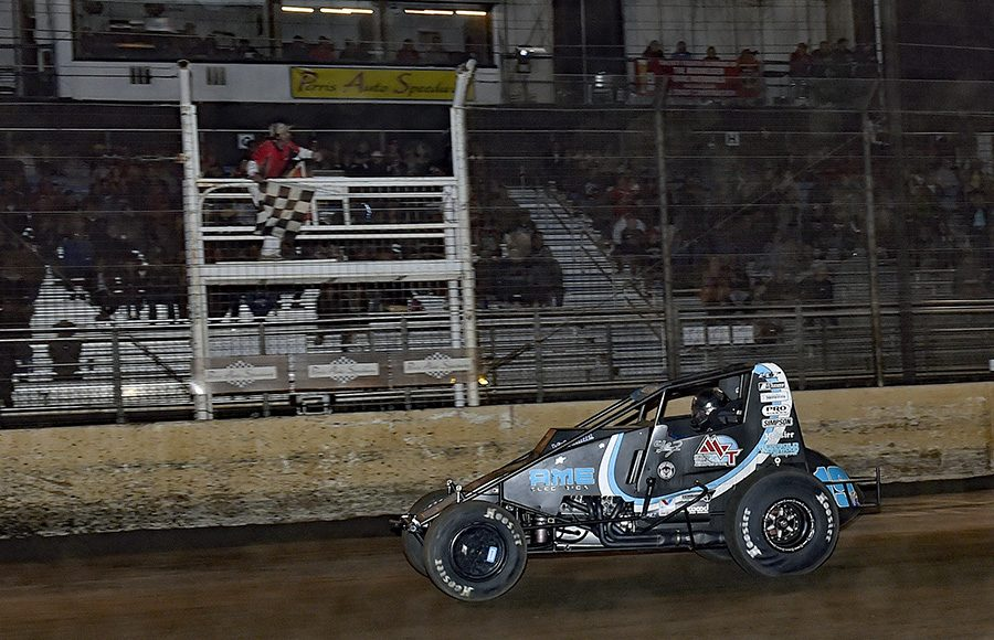 C.J. Leary takes the checkered flag to win Saturday's Oval Nationals finale at Perris Auto Speedway. (Steve Himelstein Photo)