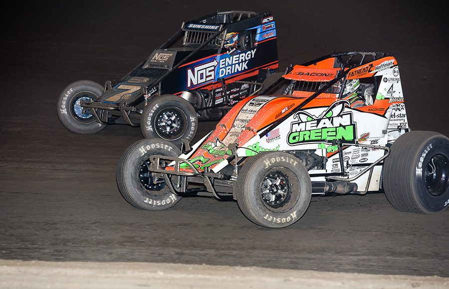 Brady Bacon (69) races under Tyler Courtney during Saturday's Oval Nationals finale at Perris Auto Speedway. (John Dadalt Photo)
