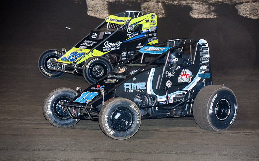 C.J. Leary (19) battles Chase Stockon for position during Saturday's Oval Nationals finale at Perris Auto Speedway. (John Dadalt Photo)
