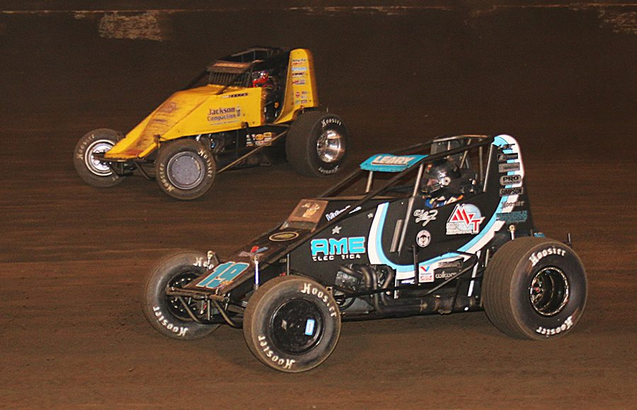C.J. Leary (19) races past Josh Hodges during Saturday's Oval Nationals finale at Perris Auto Speedway. (Doug Allen Photo)