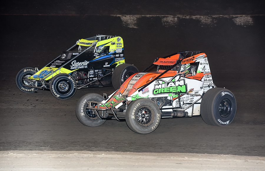 Brady Bacon (69) battles Chase Stockon during Saturday's Oval Nationals finale at Perris Auto Speedway. (John Dadalt Photo)