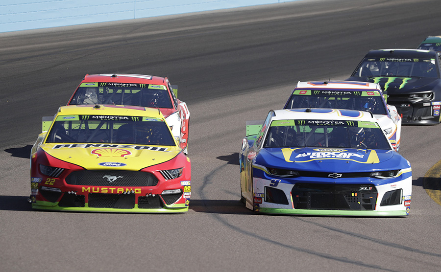 Chase Elliott (9) and Joey Logano (22) battle side-by-side during Sunday's Monster Energy NASCAR Cup Series event at ISM Raceway. (HHP/Harold Hinson Photo)