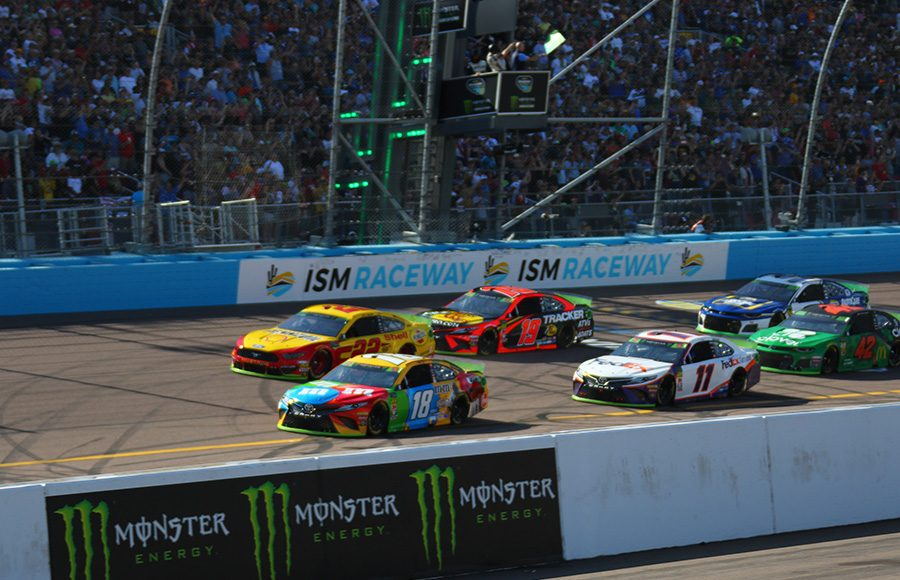 Kyle Busch (18) leads the field to the green flag to start Sunday's Monster Energy NASCAR Cup Series race at ISM Raceway. (Ivan Veldhuizen Photo)
