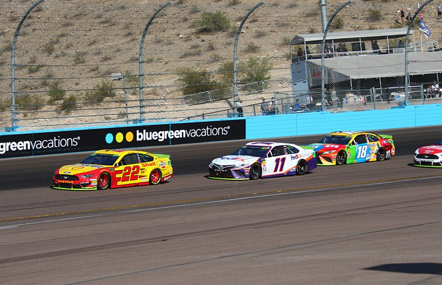 Joey Logano (22) leads Denny Hamlin (11) and Kyle Busch during Sunday's Monster Energy NASCAR Cup Series race at ISM Raceway. (Ivan Veldhuizen Photo)