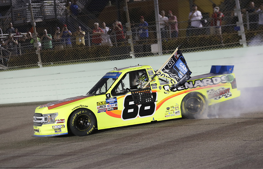 Matt Crafton celebrates after claiming his third NASCAR Gander Outdoors Truck Series championship Friday at Homestead-Miami Speedway. (HHP/Harold Hinson Photo)
