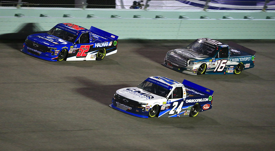 Brett Moffitt (24), Stewart Friesen (52) and Austin Hill battle for position during Friday's Ford EcoBoost 200 at Homestead-Miami Speedway. (HHP/Jim Fluharty Photo)