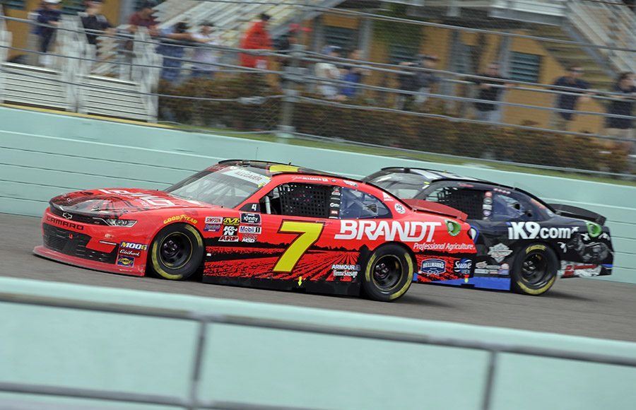 Justin Allgaier (7) races past Harrison Burton during Saturday's NASCAR Xfinity Series Ford EcoBoost 300 at Homestead-Miami Speedway. (HHP/Alan Marler Photo)