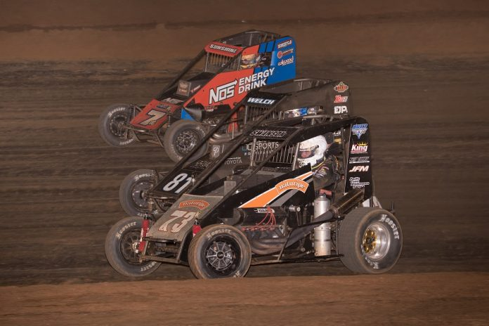 Jake Swanson (73), Dillon Welch (81) and Tyler Courtney go three-wide during the Elk Grove Ford Hangtown 100 at Placerville Speedway. (Devin Mayo photo)