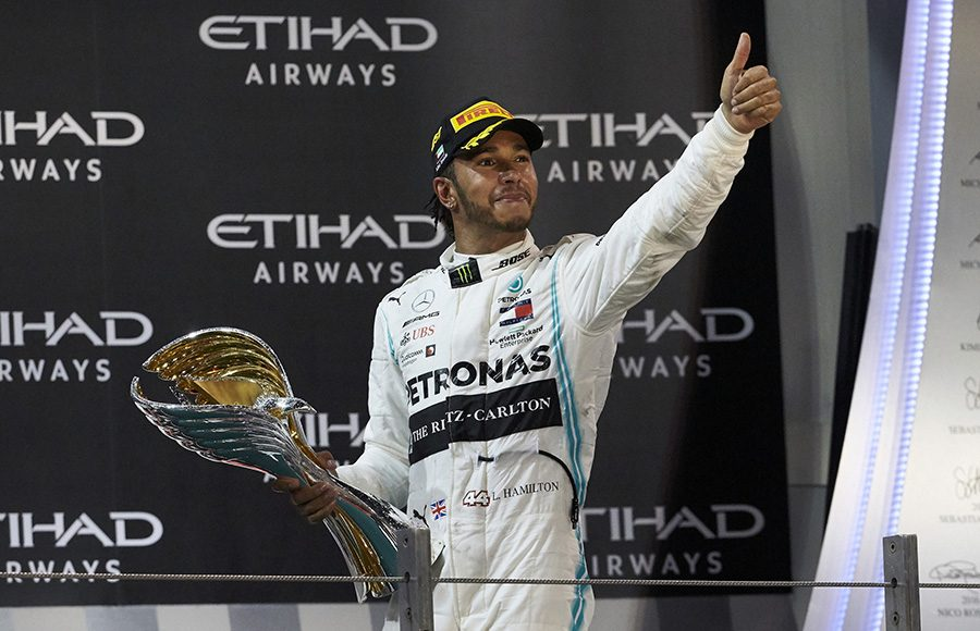 Lewis Hamilton celebrates on the podium after winning Sunday's Abu Dhabi Grand Prix. (Steve Etherington Photo)