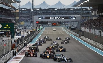 Lewis Hamilton (44) leads the Formula One field into first corner at the start of Sunday's Abu Dhabi Grand Prix. (Steve Etherington Photo)