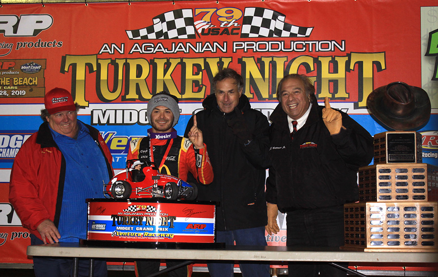 Kyle Larson poses in victory lane after winning Friday's Turkey Night Grand Prix feature at Ventura Raceway. (Richard Bales Photo)