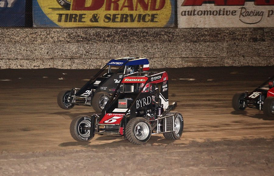 Kevin Thomas Jr. (5) battles under Chase Johnson during Friday's Turkey Night Grand Prix feature at Ventura Raceway. (Richard Bales Photo)