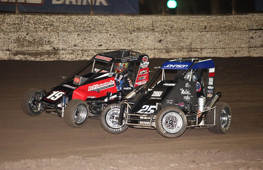 Chase Johnson (25) battles Spencer Bayston during Friday's Turkey Night Grand Prix feature at Ventura Raceway. (Richard Bales Photo)