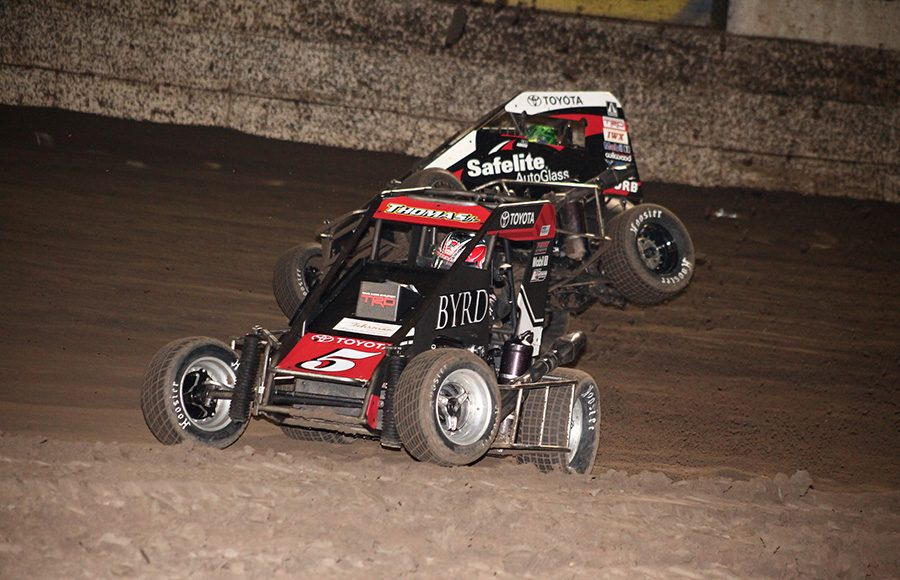 Kevin Thomas Jr. (5) races under the bouncing car of Rico Abreu during Friday's Turkey Night Grand Prix feature at Ventura Raceway. (Richard Bales Photo)