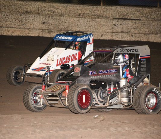 Cannon McIntosh (08) battles Kyle Larson for the race lead during Friday's Turkey Night Grand Prix feature at Ventura Raceway. (Richard Bales Photo)