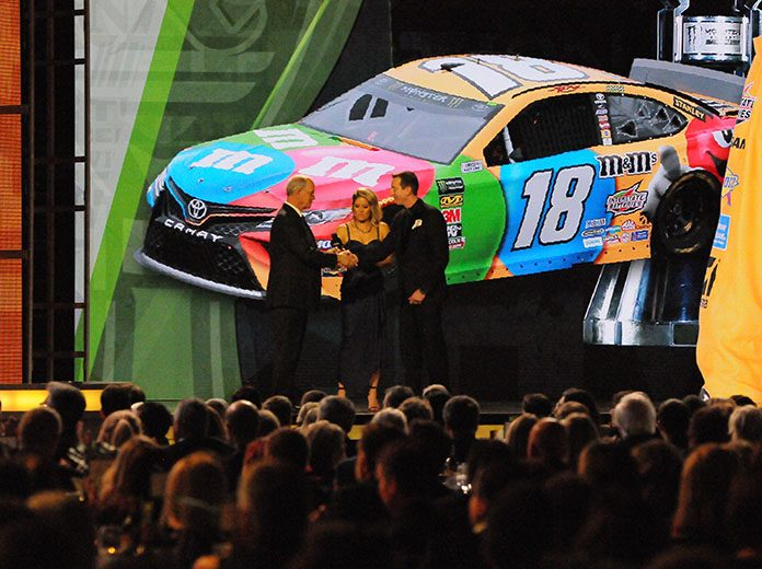 Kyle Busch receives his Monster Energy NASCAR Cup Series championship ring from NASCAR's Jim France during Thursday's NASCAR Cup Series Awards event in Nashville, Tenn. (Dave Moulthrop Photo)