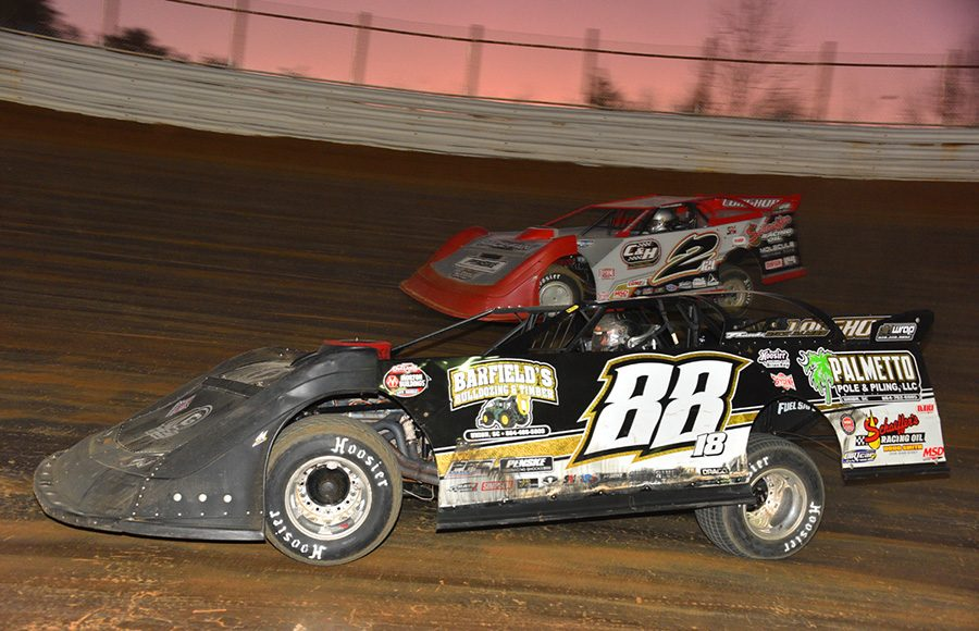 Trent Ivey (88) races past Pearson Lee Williams during Saturday's Drydene Xtreme DIRTcar Series event at Volunteer Speedway. (Michael Moats Photo)