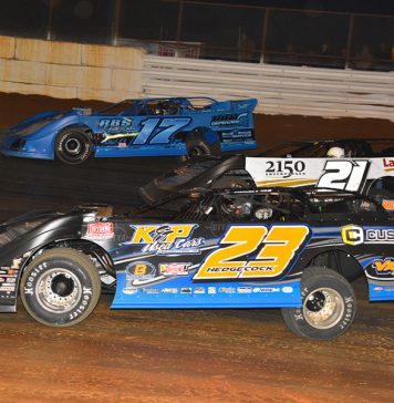 Cory Hedgecock (23), Robby Moses (21) and Logan Roberson race three-wide during Saturday's Drydene Xtreme DIRTcar Series event at Volunteer Speedway. (Michael Moats Photo)