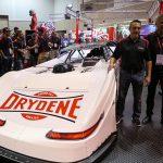 Scott Bloomquist Racing's Chris Madden (left) poses Drydene President Dave Klinger Thursday at the PRI Trade Show. (Adam Fenwick Photo)