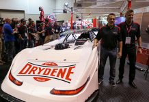 Scott Bloomquist Racing's Chris Madden (left) poses Drydene President Dave Klinger Thursday at the PRI Trade Show. (Adam Fenwick Photo)