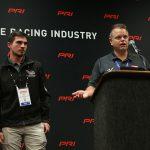 Billy Venturini (right) announces Mason Diaz as the driver of the Venturini Motorsports entry in the ARCA Menards Series East on Saturday at the PRI Trade Show. (Adam Fenwick Photo)