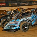 Mike Harrison (24) races to the inside of Kyle Bronson early in Friday's Gateway Dirt Nationals modified preliminary feature inside The Dome at America's Center. (Jim Denhamer Photo)
