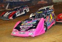 Rusty Schlenk (91) leads a pack of cars during Saturday's Gateway Dirt Nationals finale. (Jim DenHamer photo)