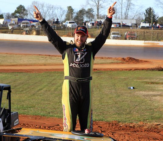 Donald McIntosh celebrates after winning the Hangover super late model feature Saturday at 411 Motor Speedway. (Chad Wells Photo)