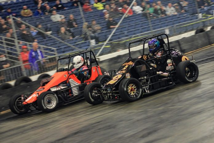 Tony Stewart (2) pressures Joe Liguori during the 2019 Rumble in Fort Wayne finale inside the Allen County War Memorial Coliseum. (Blake Harris photo)