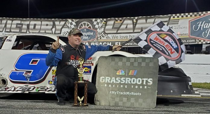 Brad May in victory lane Saturday at New Smyrna Speedway. (NASCAR Photo)