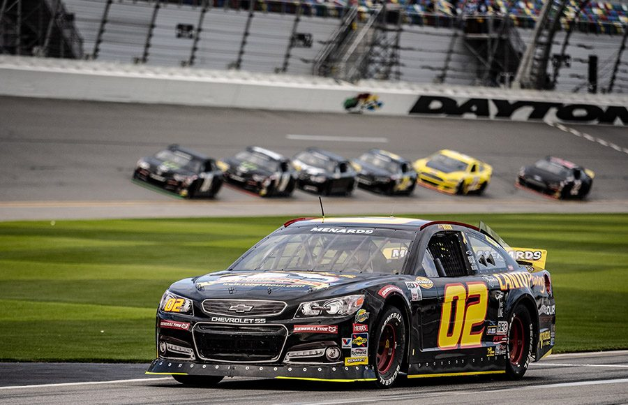 The Our Motorsports No. 02 Chevrolet drives down pit road as cars storm by during the ARCA Menards Series test at Daytona Int'l Speedway. (Jason Reasin Photo)