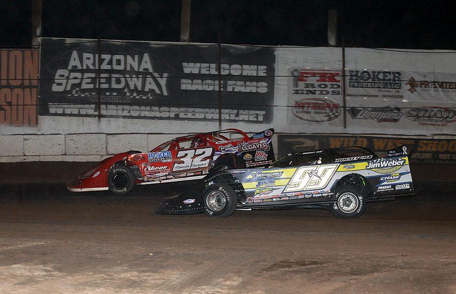 Bobby Pierce (32) battles Frank Heckenast Jr. during Saturday's Wild West Shootout feature at Arizona Speedway. (Mike Ruefer Photo)
