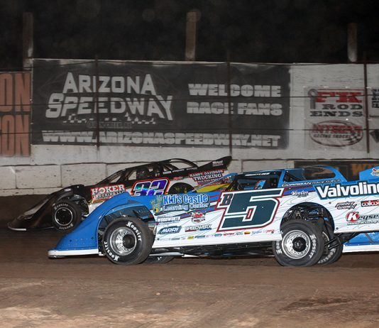 Brandon Sheppard (B5) races under Chris Simpson during Saturday's Wild West Shootout feature at Arizona Speedway. (Mike Ruefer Photo)
