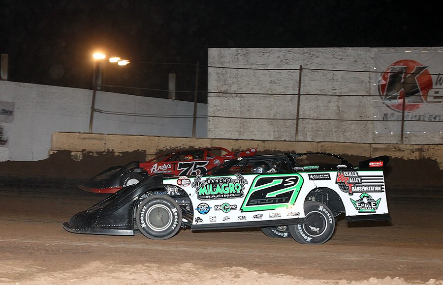 Stormy Scott (2s) races under Terry Phillips during Saturday's Wild West Shootout feature at Arizona Speedway. (Mike Ruefer Photo)